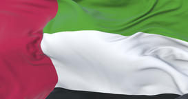 Flag of the United Arab Emirates waving at wind in slow with blue sky, loop Animation