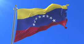 Venezuela flag waving at wind in slow with blue sky, loop Animation