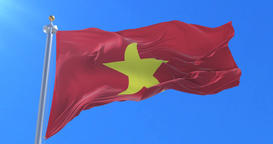 Flag of Vietnam waving at wind with blue sky, loop Animation