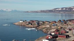 Houses in mountains on shore of of Greenland in Arctic Ocean Serene Footage