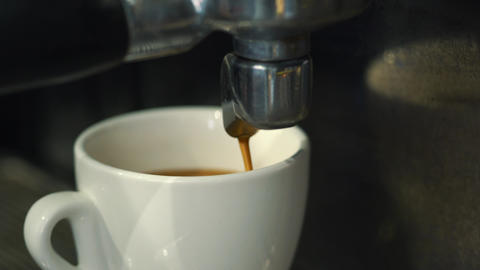 Coffee machine pouring espresso in cup Footage