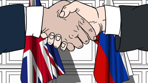 Businessmen or politicians shaking hands against flags of Great Britain and Live Action
