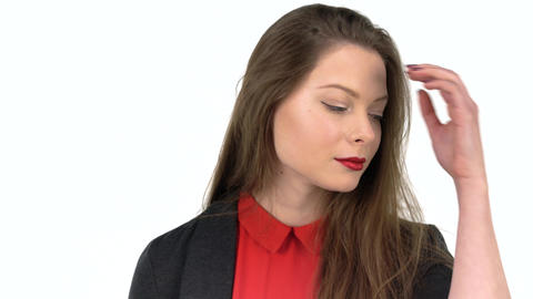 Young beautiful woman looking at camera happy and adjusts her hair Footage
