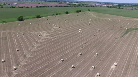 Aerial video of hay bails in a field Footage