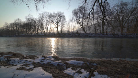 Peaceful morning with sunrise on the river bank Dolly shot Footage