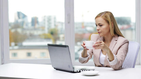 businesswoman with laptop and coffee at office Footage