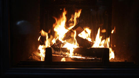 close up of firewood burning in fireplace Footage