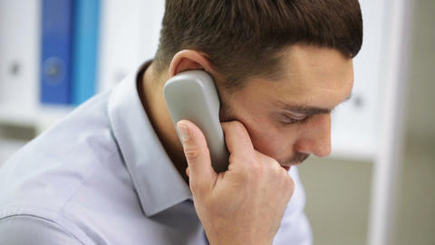 Businessman With Laptop Calling On Phone stock footage