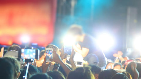 concert crowd with smartphones shooting rock star Footage