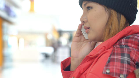 Young asian Woman talking on cell phone Footage