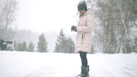 Young Woman during heavy snowfall Footage