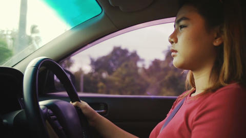 Young woman driving car slowmotion Footage