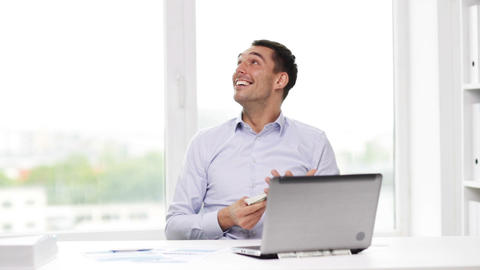 happy businessman with money and laptop in office Footage