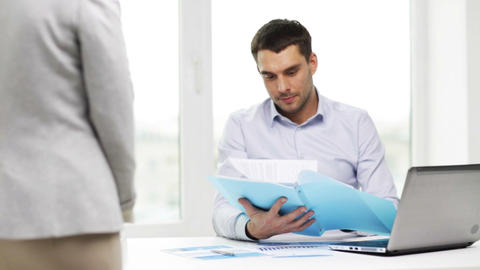 businessman with papers and secretary in office Footage