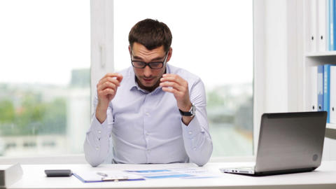 busy businessman with laptop and papers in office Live Action