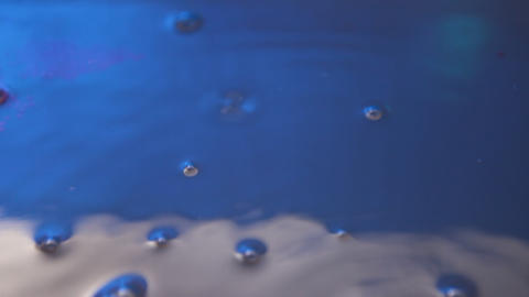 Air bubbles in Blue water Live Action