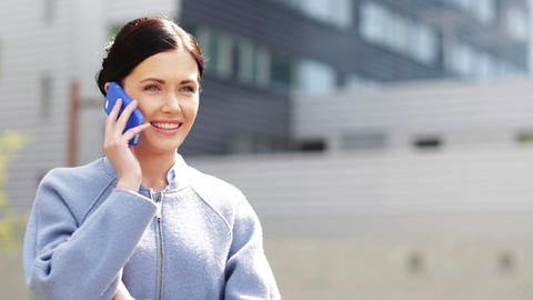young smiling businesswoman calling on smartphone Footage