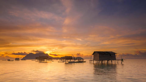 Sunrise time lapse at sea gypsy's huts Live Action