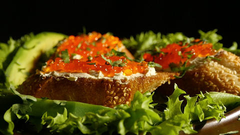 Sandwiches with red caviar on a plate Stock Video Footage