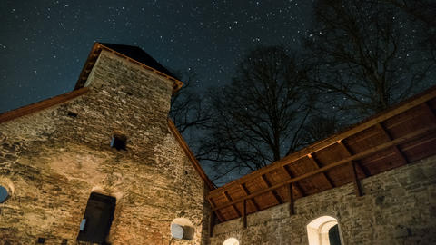 Night sky over historic church ruin Time lapse Footage