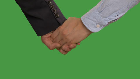 Business couple in formal wear holding hands, keyed green screen Footage
