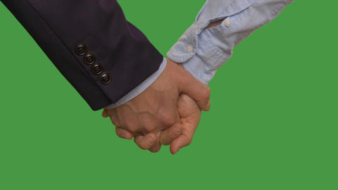 Business couple holding hands in lock. Alpha channel, keyed green screen Footage