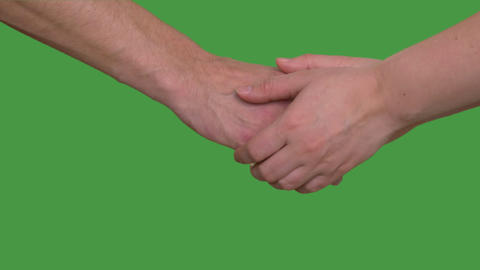 Friends shaking hands. Handshake wiht two hands, keyed green screen Footage