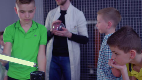 Boys explores Tesla coil and lamp in museum of popular science and technologies Live Action