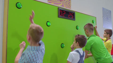 Group of children play a game of reaction speed in scientific museum Footage