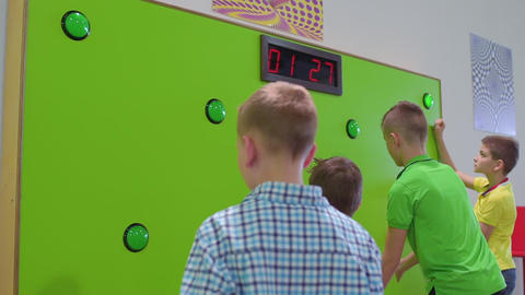 Group of children play a game of reaction speed in... Stock Video Footage