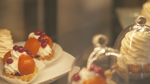 Different sweet cakes in bakery cafe close up. Confectionery cakes in candy shop Footage