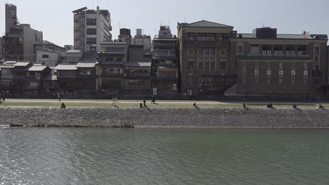People walking in the Kamogawa riverside Kyoto Japan 영상물