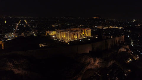 Aerial night video of iconic ancient Acropolis hill and the Parthenon at night, Live Action