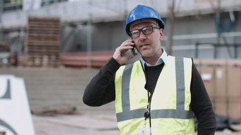 Construction worker using smart phone on construction site Footage