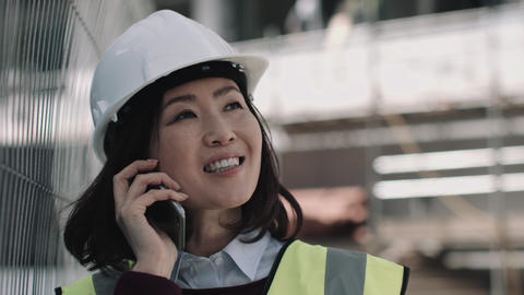 Architect speaking on phone on construction site Live Action