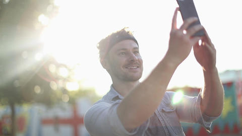 Trendy male taking selfie Live Action