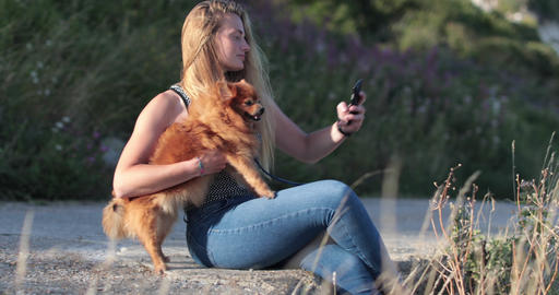 Young adult female taking selfie with dog ビデオ