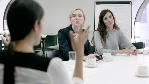 Women Working Together in meeting room Footage