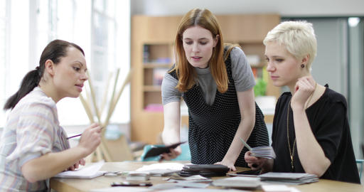 Female designers looking at samples in a meeting Footage