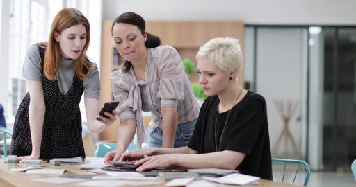Female designers using smartphone to document project planning Footage