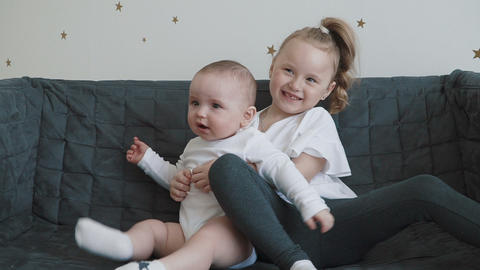Cute little girl and baby boy playing Footage