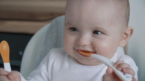 Portrait of a cute baby boy eating Footage