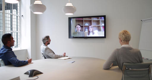 Colleagues on a video conference call in a business meeting Footage