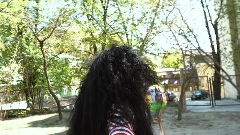 Beautiful happy brunette leads camera through a park, follow me concept Footage