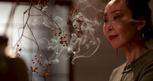 Japanese woman at home contemplating and smelling incense, Kyoto Japan GIF