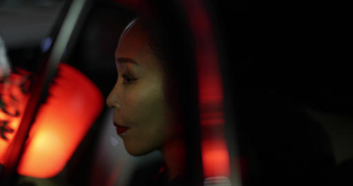 Japanese woman in Kimono in taxi looking out of window in Japan, Kyoto GIF