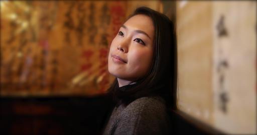 Pretty Japanese woman contemplating. Tokyo, Japan ビデオ