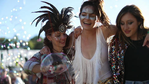 Female friends dancing at summer festival GIF