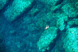 Drone view of a couple snorkeling in tropical sea フォト