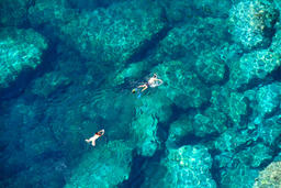 Drone view of a couple snorkeling in tropical sea Photo